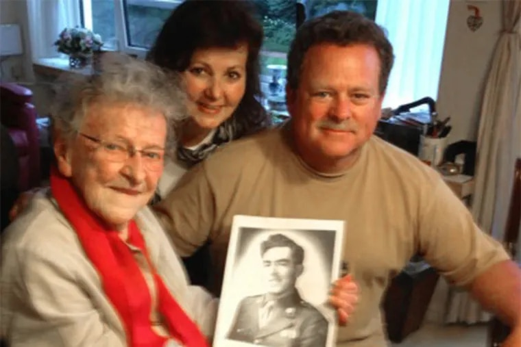 Joe and Eileen Garrity in August in the Netherlands with Jane van Haaren, holding a photo of his uncle, Pvt. Joseph Garrity. She knew him for just a few days but still felt connected to him long after.