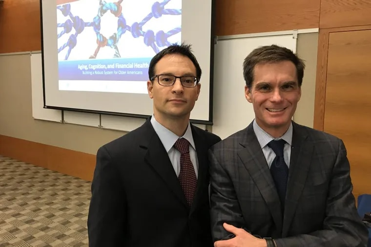 The Philadelphia Federal Reserve Bank's Larry Santucci (left) and Dr. Jason Karlawish of the Penn Memory Center hosted the  joint conference Nov. 28-29 addressing financial  abuse among older Americans, specifically those with cognitive difficulties.