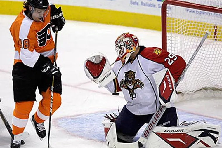 Panthers' goalie Tomas Vokoun stops the puck during the Panthers' 5-0 shutout of the Flyers. (Yong Kim / Staff Photographer)