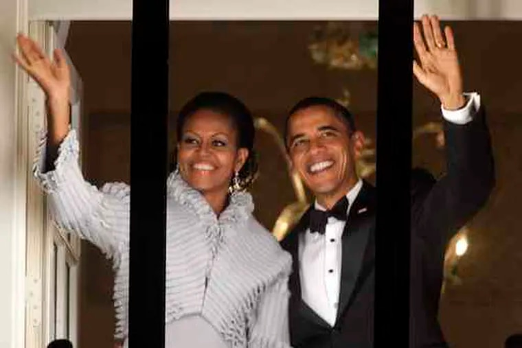 President and Michelle Obama wave to the crowd from a balcony at the Grand Hotel in Oslo after he accepted the Nobel Peace Prize at City Hall. His acceptance speech offered a lofty, ideological justification for sending more troops to Afghanistan.