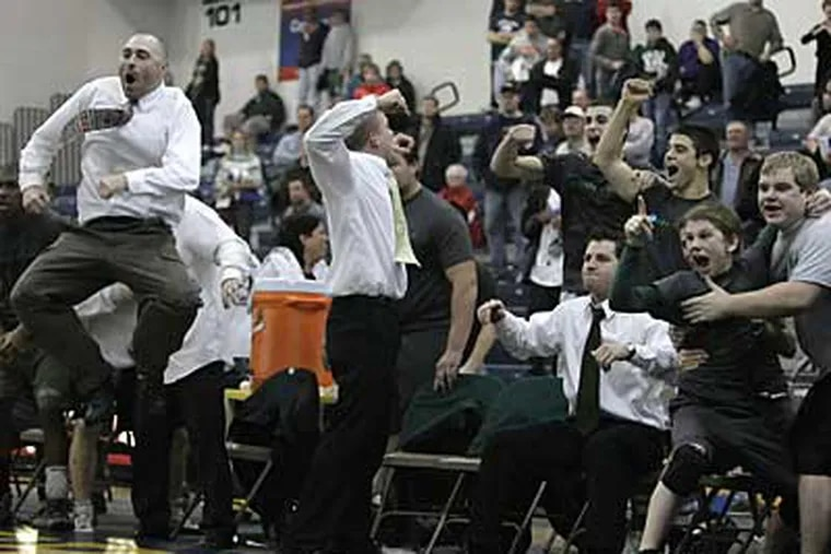 Camden Catholic's head coach,Pete DiPol,far left, celebrates with the rest of his team after winning the last match and the championship. (Ron Cortes / Inquirer).