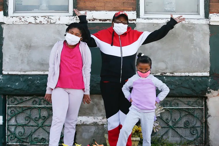Thelma Weeks (center) with and her great grand-daughters Khadija Weeks (left), 9 and Khadirah Weeks, 5 at their Strawberry Mansion home on Saturday, April 25, 2020.  Grandparents are raising their grandkids trying to navigate the pandemic with limited resources, technology know-how or back-up support.