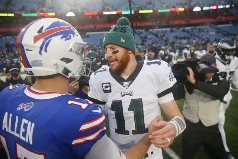 Philadelphia Eagles quarterback Carson Wentz (right) shakes hands with Buffalo Bills quarterback Josh Allen (left) after the Eagles' 31-13 win at New Era Stadium.