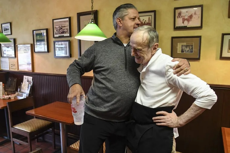 """After shouting, """"No one consulted me! Where am I going to eat?"""" Brady Kramer (left) hugs Jim Landis, 79, co-owner of his family's  Landis Restaurant in Wayne, which he plans to close after 50 years unless a new owner can be found."""
