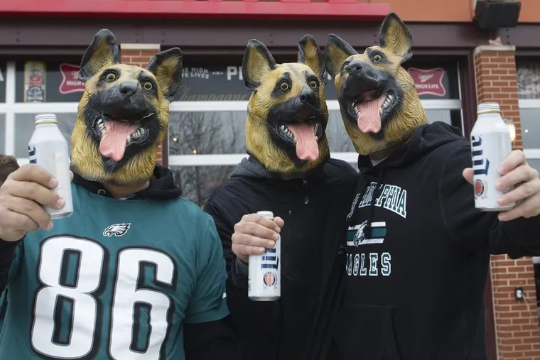 Eagle fans, Adam Gatsis, left, Nick Paris, center, and Mike Stergion, from Toronto, Canada, posed for a photograph wearing dog masks during a tailgate party outside Lincoln Financial Field, Philadelphia. Sunday, January 21, 2018. JOSE F. MORENO/ Staff Photographer