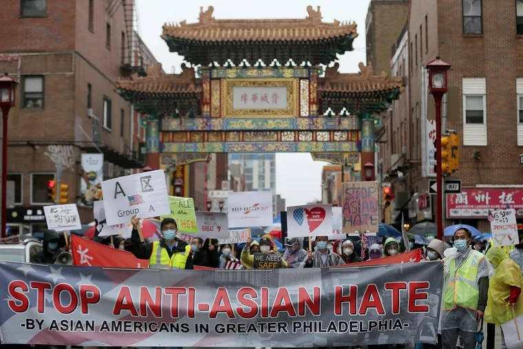 Supporters line up on 10th and Arch Street at the Chinatown Friendship Gate during the Stop Anti-Asian Hate rally in Philadelphia, Pa. on March 28, 2021.