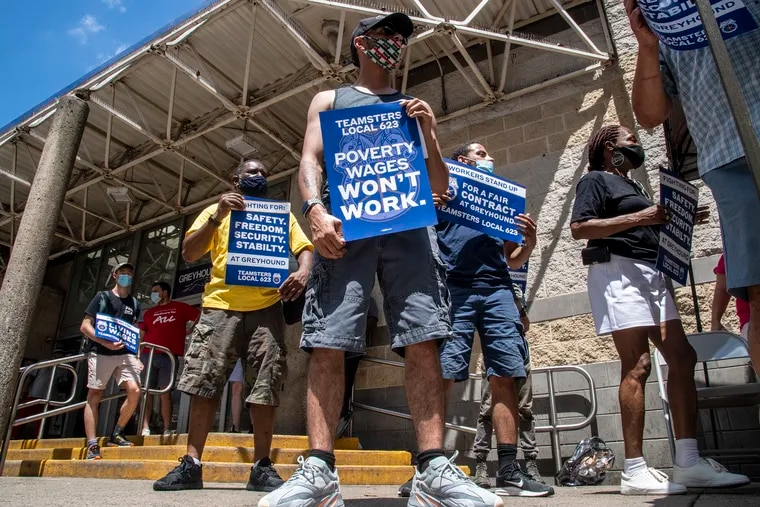 Jerrod Martinez (front) protests during a rally for Greyhound workers at the Greyhound Station on 1001 Filbert St. in Philadelphia.