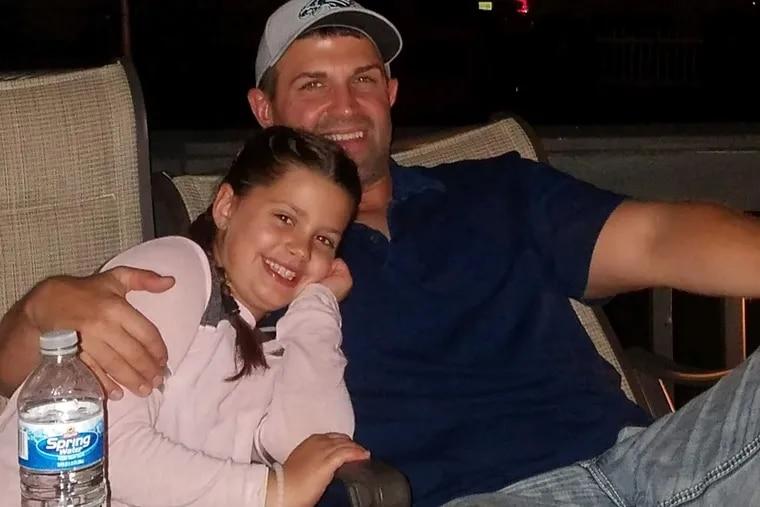 John Clausen, 46, of Gibbstown, N.J., with his daughter.