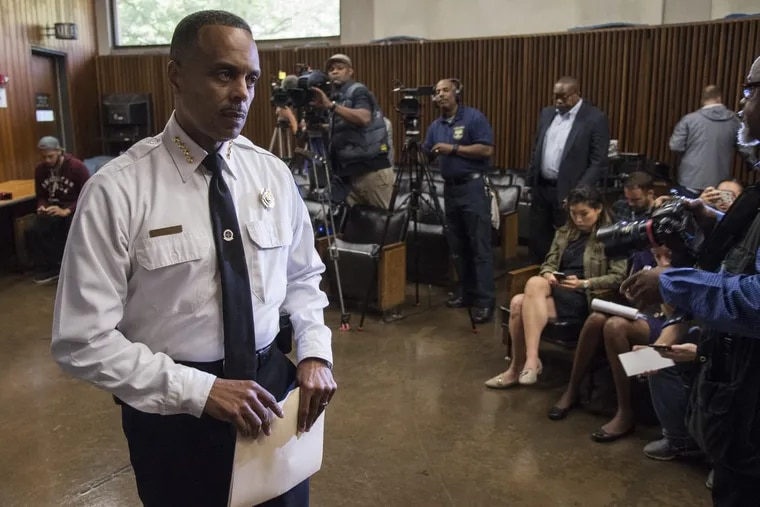 Philadelphia Police Commissioner Richard Ross leaves a news conference after announcing that Officer Ryan Pownall, a 12-year veteran of the force, would be fired.