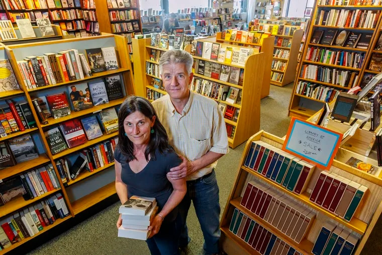 """Penn Book Center owners  Ashley Montague, left, and Michael Row,right, are trying to keep their university city bookstore open despite suffering from the """"Amazon Effect""""."""