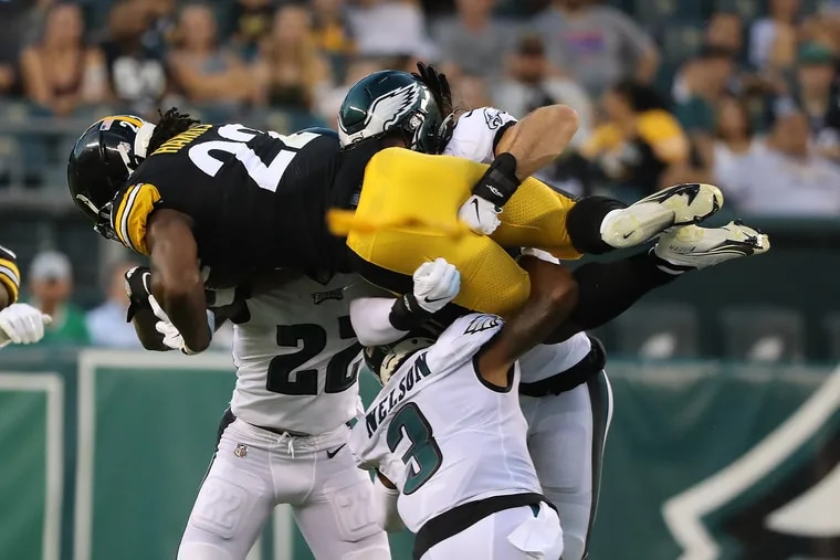 Eagles (left to right) Marcus Epps, Steven Nelson, and Alex Singleton tackled Steelers running back Najee Harris during their preseason game on Aug. 12.