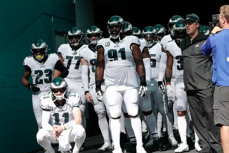 Eagles players wait in the tunnel before playing the Dolphins in Miami.