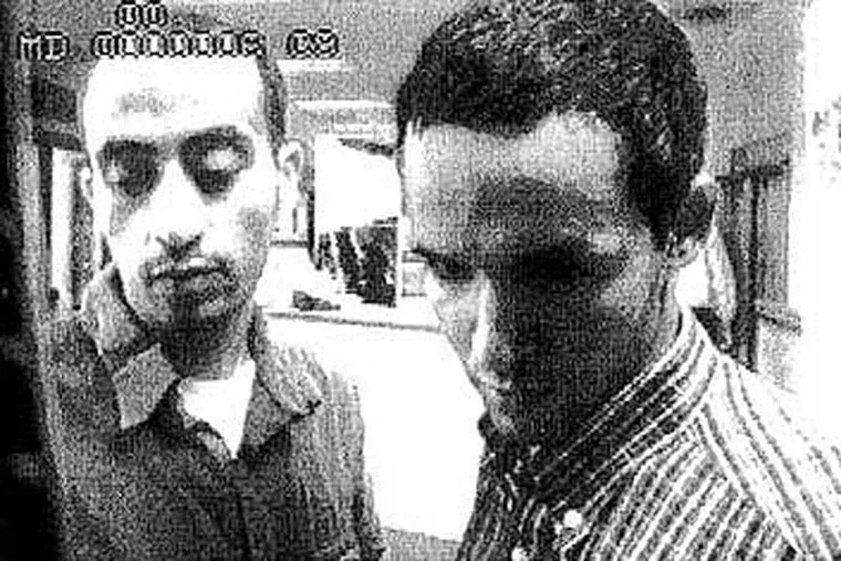 Hani Hanjour (left) and Majed Moqed in a surveillance video on September 5, 2001. Hanjour, a Saudi Arabian  who piloted the plane that was flown into the Pentagon, was the only one of the 19 terrorists in the U.S. on a student visa.