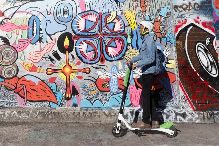 An electric scooter from Lime, one of several companies crowding into cities around the country, often without permission.