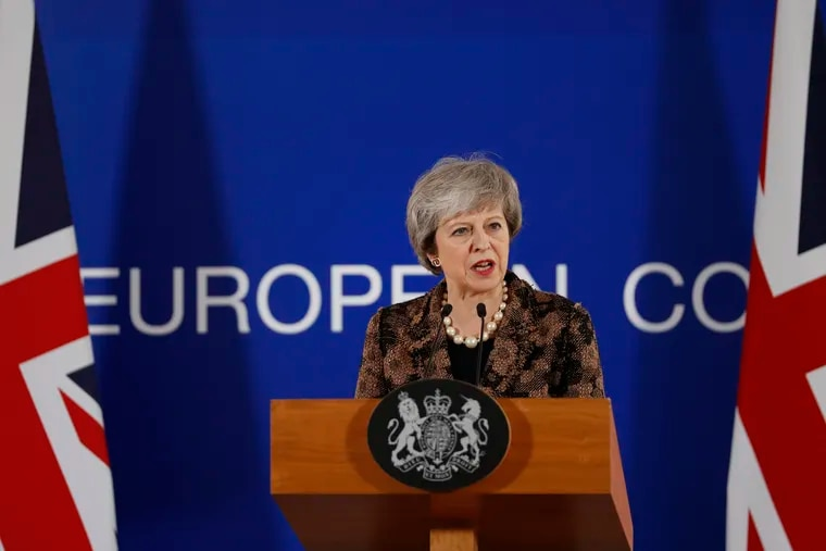 British Prime Minister Theresa May speaks during a media conference at an EU summit in Brussels, Friday, Dec. 14, 2018. European Union leaders expressed deep doubts Friday that British Prime Minister Theresa May can live up to her side of their Brexit agreement and they vowed to step up preparations for a potentially-catastrophic no-deal scenario. (AP Photo/Alastair Grant)