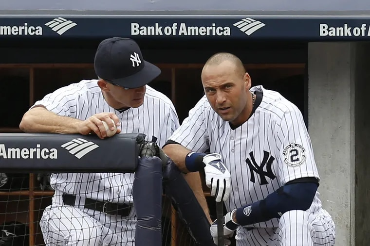 Phillies manager Joe Girardi, left, was both a teammate and manager of Derek Jeter's with the New York Yankees.