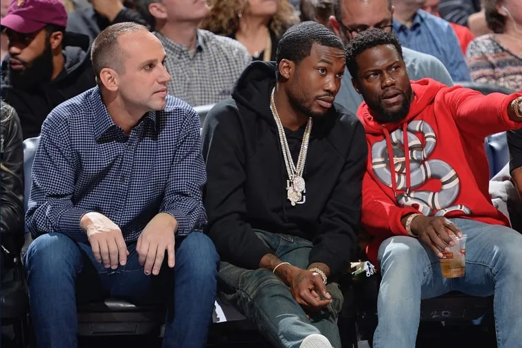 Meek Mill (center) with Kevin Hart and minority 76ers owner Michael Rubin at a game last season.