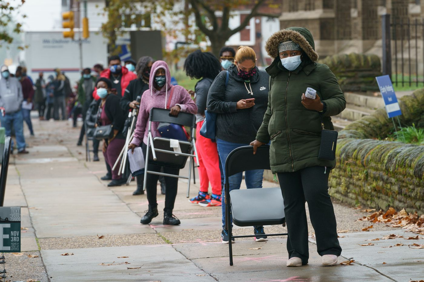 Voters across Philly wait through rain, cold, and long lines as window to cast ballots early closes