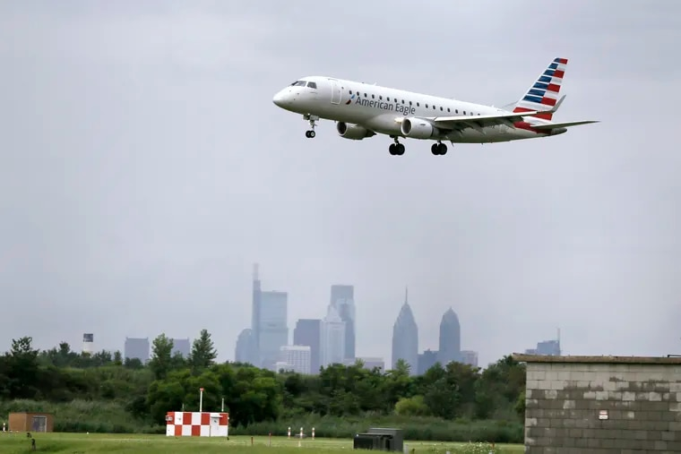 An American Eagle plane lands at Philadelphia International Airport on July 18, 2019.