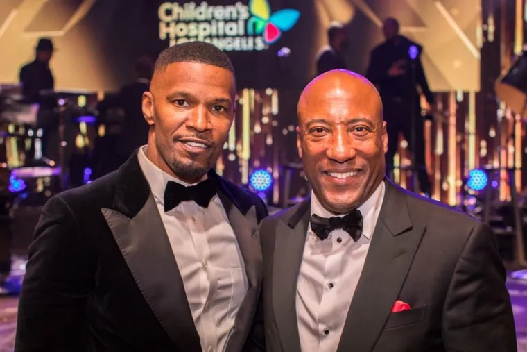 Actor and singer Jamie Foxx with Byron Allen at the Oscar Gala in February.