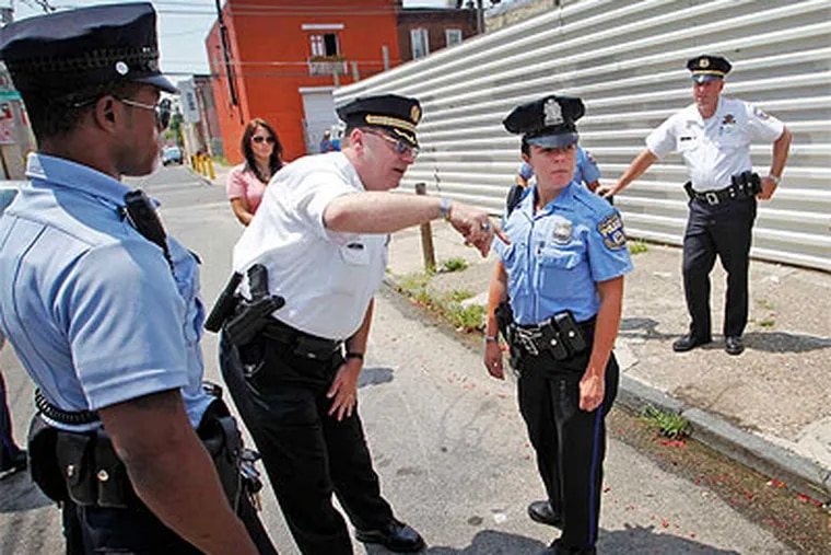 Capt. Charles Vogt of the 24th District has established a police presence on Hartville Street between Indiana and Clearfield in Kensington as part of his Block by Block plan. (Alejandro A. Alvarez / Staff Photographer)