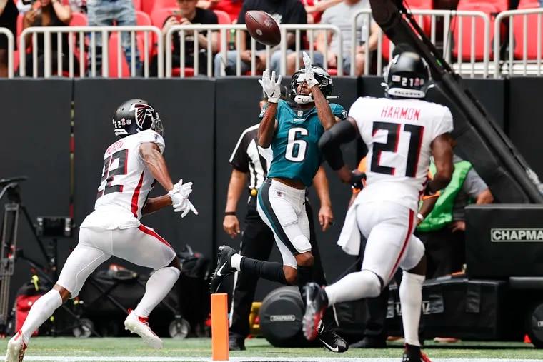 Eagles wide receiver DeVonta Smith catches a first-quarter touchdown past Atlanta Falcons cornerback Fabian Moreau (left) and strong safety Duron Harmon.
