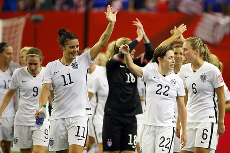 United States team members wave to the crowd after the semifinals against Germany in the FIFA 2015 Women's World Cup at Olympic Stadium. United States defeated Germany 2-0. Mandatory (Jean-Yves Ahern/USA Today)