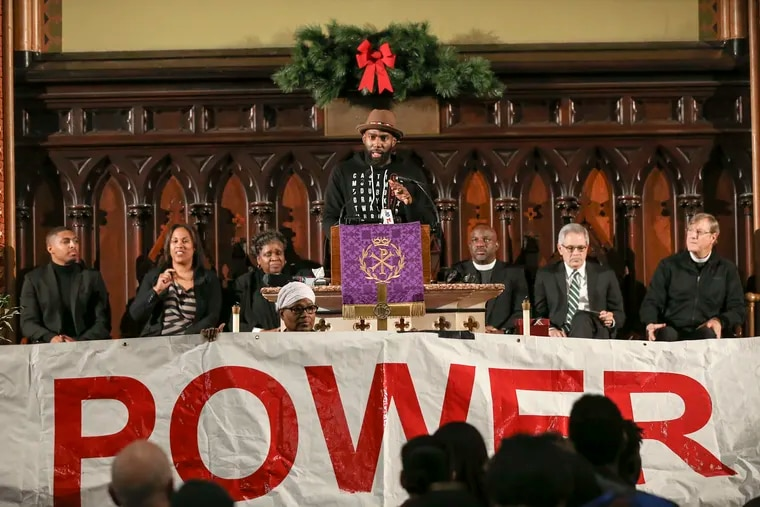 Philadelphia Eagles safety Malcolm Jenkins speaks to dozens of attendees at a rally at Arch Street United Methodist Church on Monday, Dec. 16, 2019, demanding transparency and accountability in the selection of the next police commissioner and the police contract process.