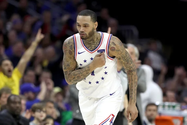 Mike Scott of the Sixers pounds his chest after hitting a three-pointer against the Warriors at the Wells Fargo Center during the second half on March 2, 2019.