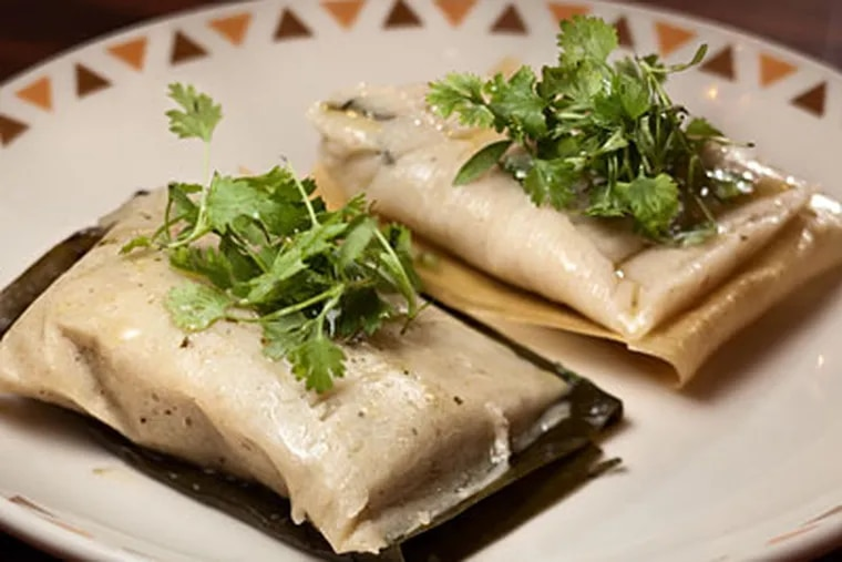 Chicken tamales with salsa verde, banana leaf and Chihuahua cheese in corn husk. (DAVID M WARREN / Staff Photographer)