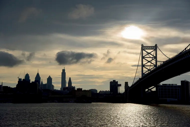 The Delaware River flows under the Ben Franklin Bridge and past Philadelphia.