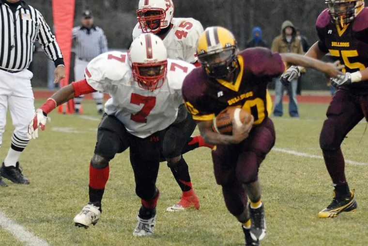 Glassboro's Steven Davis eludes Penn Grove's Chris Georges to score a touchdown in the fourth quarter. Davis gained 66 yards on 13 carries.