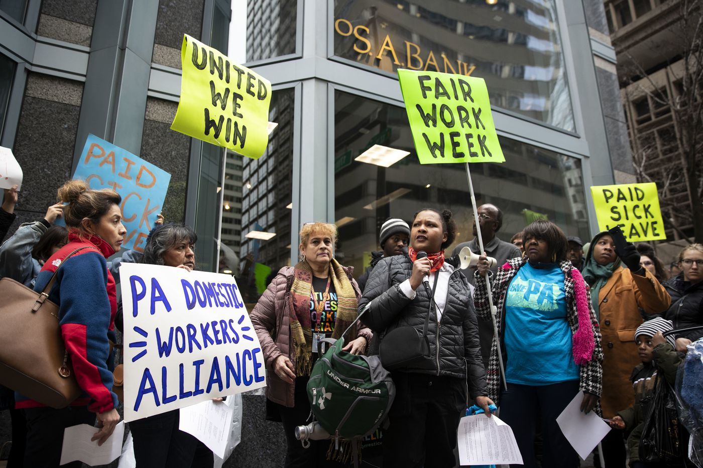 People march down Market Street towards Philadelphia City Hall for a press conference in Philadelphia, Pa. on Wednesday, February 12, 2020. The Coalition to Respect Every Worker (CREW) marched in support of stronger labor enforcement in city government.