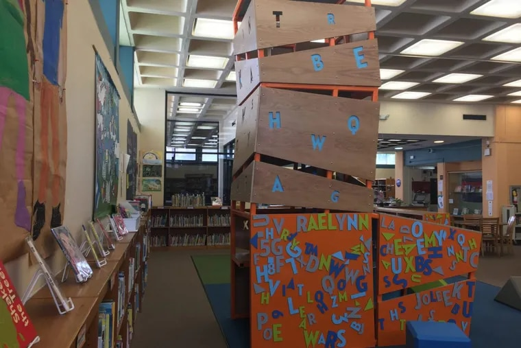This 10-foot-tall structure at Whitman Library encourages kids to run, climb and play. Whitman Library is one of three with such playgrounds as part of a Free Library of Philadelphia initiative to develop new techniques to encourage early childhood literacy.