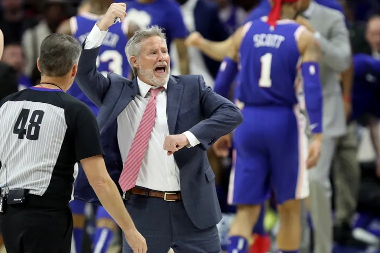 Coach Brett Brown of the Sixers argues with an official during their game against the Nets their NBA playoff game at the Wells Fargo Center on April 13, 2019.