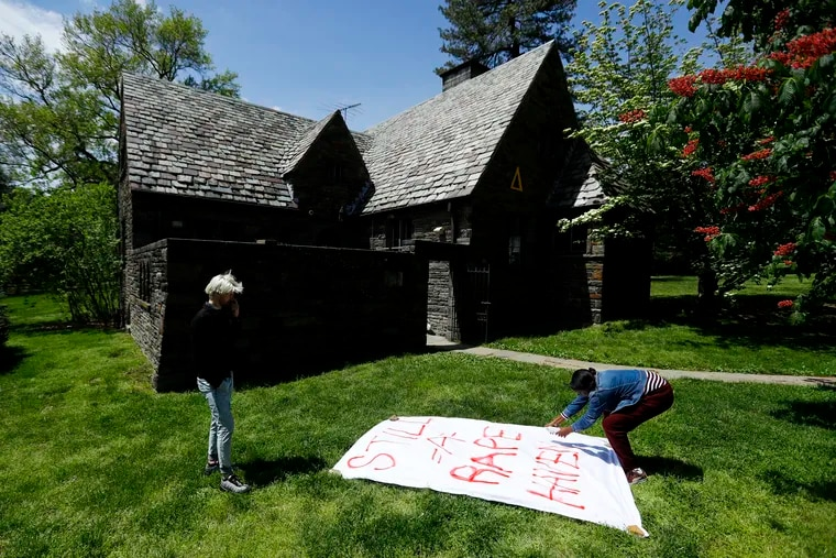Swarthmore College students paint a banner to hang outside the Phi Psi fraternity house during a sit-in, Monday, April 29, 2019, in Swarthmore, Pa. Students at the suburban Philadelphia college have occupied the on-campus fraternity house in an effort to get it shut down after documents allegedly belonging to Phi Psi surfaced this month containing derogatory comments about women and the LGBTQ community and jokes about sexual assault. (AP Photo)