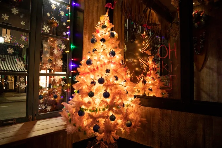 Tiki bar on South 13th Street is decorated for holidays with christmas trees, lights, stockings, and their original tiki decorations on Thursday, Dec. 5, 2019.