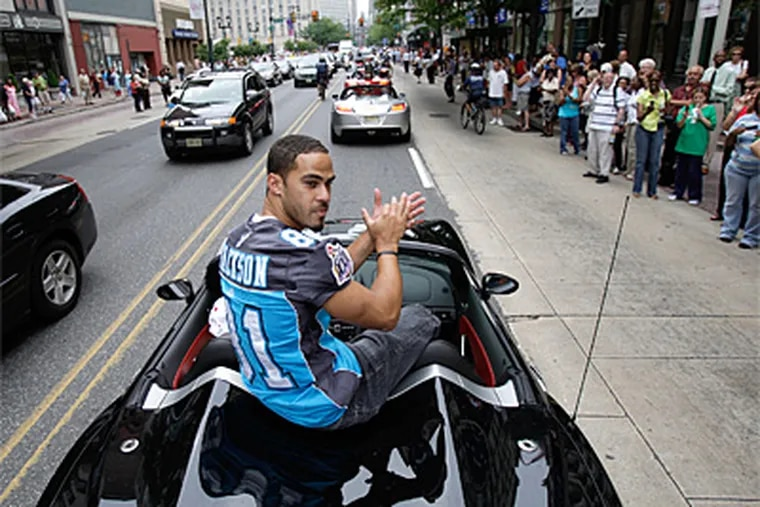 Receiver Chris Jackson claps as he rolls along Market Street near 7th Street as the Philadelphia Soul football team celebrated its Arena Bowl Championship with a motorcade along Market Street in Philadelphia on Thursday. The procession ended at City Hall with a victory celebration featuring Jon Bon Jovi. (David Maialetti / Philadelphia Daily News)