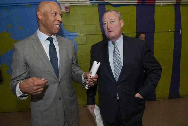 (left-right) Philadelphia Public School Superintendent William R. Hite and Mayor Jim Kenney talking before a program at Hartranft Elementary School.