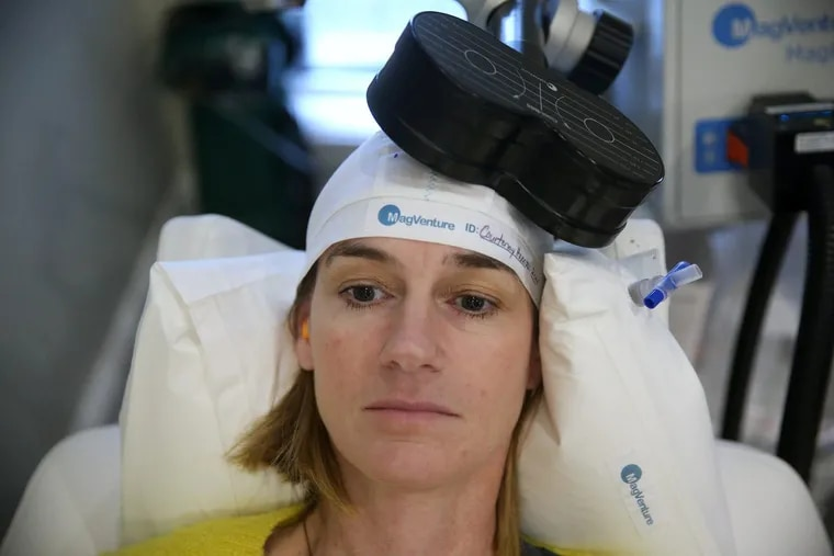 Courtenay Harris Bond prepares to receive a transcranial magnetic stimulation treatment from psychiatrist John O'Reardon at his Voorhees practice.