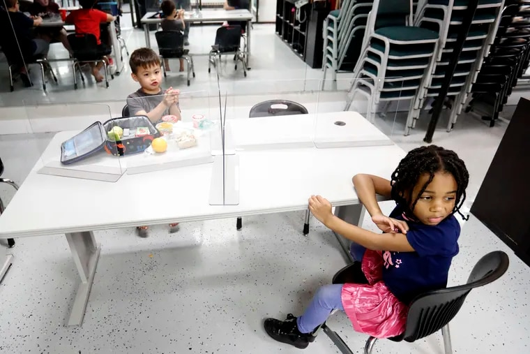 In-person summer camp won't happen for 3,000-plus children in Philadelphia because the Philadelphia School District has opted not to open its buildings to city providers, as it has for years. The district says the pandemic prevents it from making facilities available, a position advocates dispute. Here, children at a Texas camp are shown with plastic barriers separating them to stop the spread of the coronavirus.