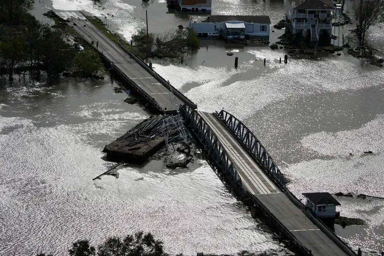 A barge damages a bridge between Lafitte, La., and Jean Lafitte, in the aftermath of Hurricane Ida.