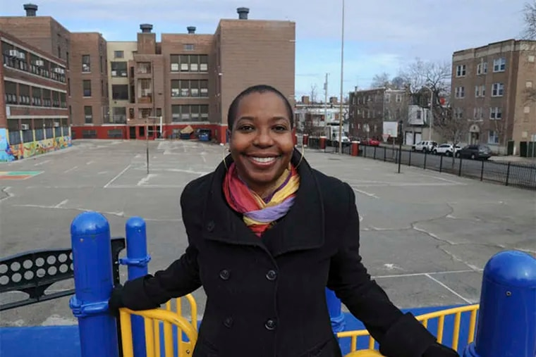 Asali Solomon, in front of Henry C. Lea School in West Philly, where she went. She then attended the Baldwin School in Bryn Mawr. (CLEM MURRAY / Staff Photographer)
