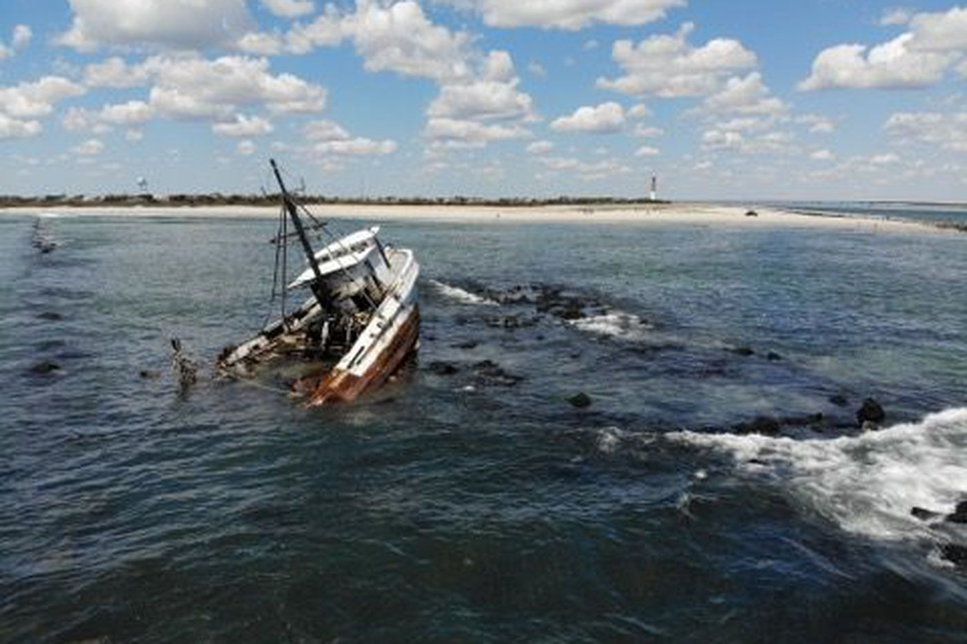 Two fishermen airlifted from vessel wrecked off Jersey Shore; boat may be a pollution threat