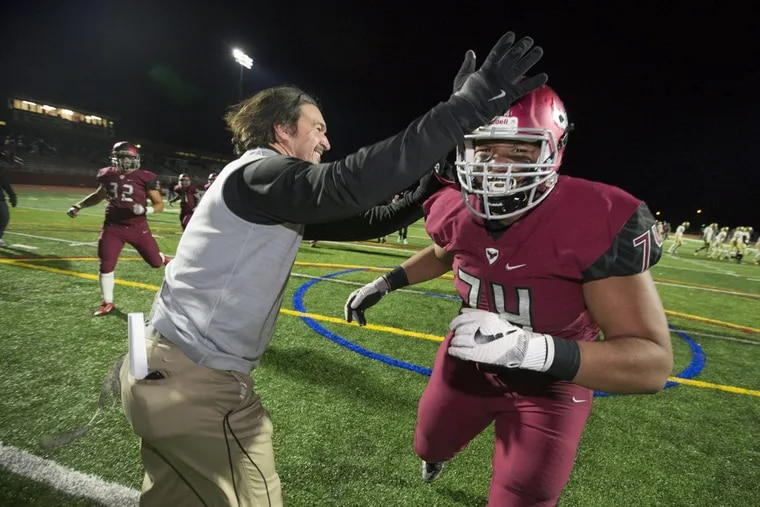 Coach Gabe Infante, left, and Casey Stephenson, right, celebrate St. Joseph's Prep 17-3 victory over La Salle in the Catholic League 6A championship on Nov. 10, 2017.