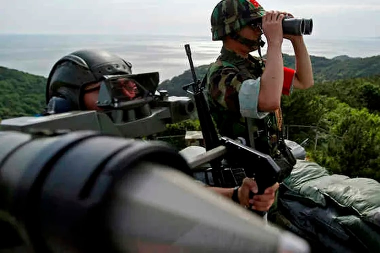 South Korean marines keep watch during a drill against possible attacks by North Korea at the South's western Yeonpyong Island. The South is bracing for a possible third nuclear missile test by the North, despite the new U.N. sanctions.