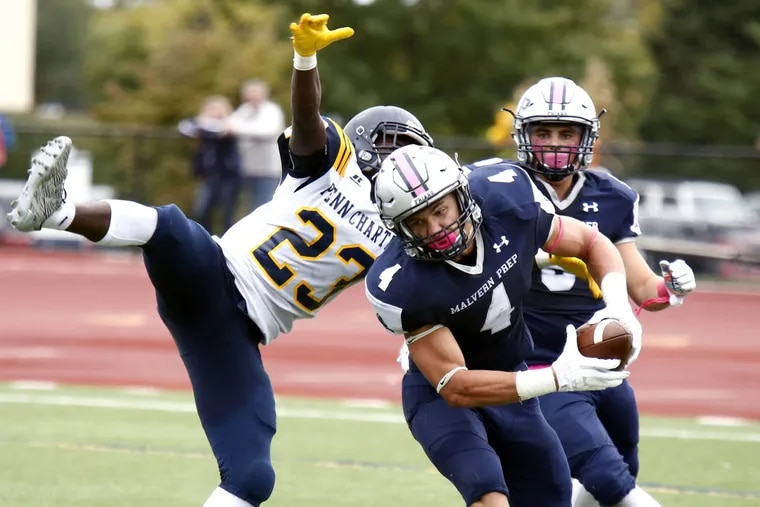 Malvern Prep linebacker Keith Maguire makes an interception in a 23-9 victory over Inter-Ac League rival Penn Charter on Oct. 14.
