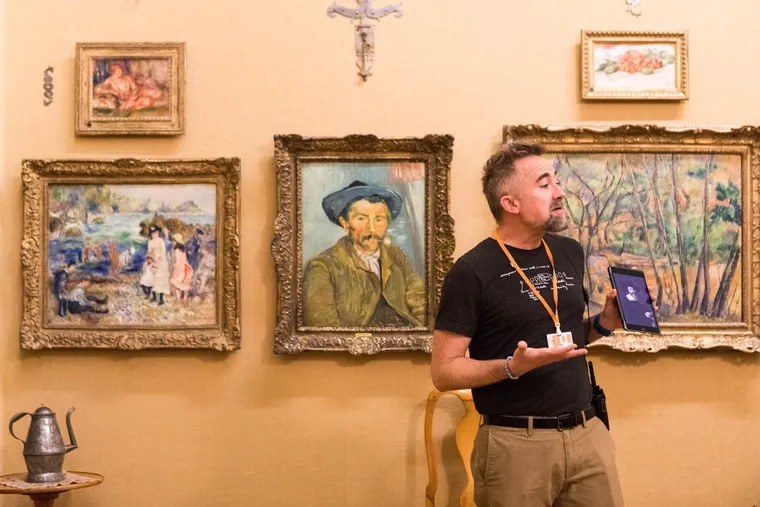 Clay Cofer, an Art Team member at the Barnes Foundation, does a pop-up gallery talk for visitors.