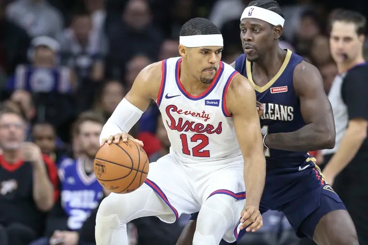 Sixers' Tobias Harris drives on Pelicans' Jrue Holiday during the 4th quarter at the Wells Fargo Center in Philadelphia, Friday, December 13, 2019.  Sixers beat the Pelicans 116-109.