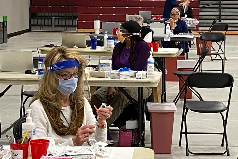 Medical staff prepare for COVID-19 vaccinations at a county vaccination clinic for health-care workers at Montgomery County Community College on Jan. 6.